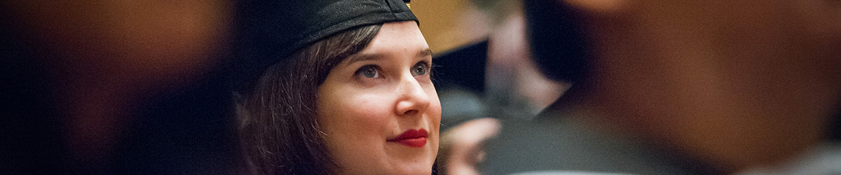 1200x350px close up photo of graduating student in cap and gown